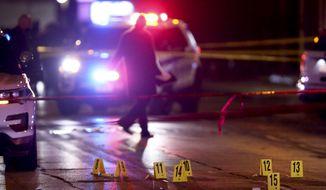 Police investigate the scene of a shooting on the Chicago-Evanston border on Saturday, Jan. 9, 2021. (Chris Sweda/Chicago Tribune via AP)