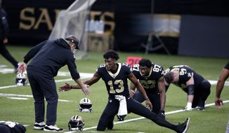 New Orleans Saints head coach Sean Payton greets wide receiver Michael Thomas (13) before an NFL wild-card playoff football game in New Orleans, Sunday, Jan. 10, 2021. (AP Photo/Butch Dill)