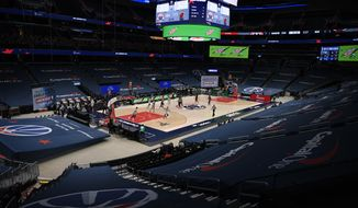 The Washington Wizards and the Miami Heat compete in a mostly empty arena during the second half of an NBA basketball game, Saturday, Jan. 9, 2021, in Washington. The Heat won 128-124. (AP Photo/Nick Wass)