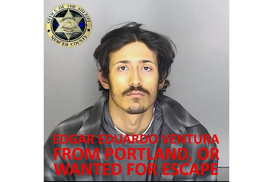"""This undated booking photo released by the Merced County Sheriff's Office shows escapee inmate Edgar Eduardo Ventura, from Portland, Ore. Authorities in central California are searching for six inmates, including Ventura, who used a """"homemade rope"""" to escape from a county jail. The Merced County Sheriff's Office says all six should be considered armed and dangerous. Staff at Merced County Downtown Jail noticed late Saturday, Jan.10, 2021, that the six inmates were missing. (Merced County Sheriff's Office via AP)"""