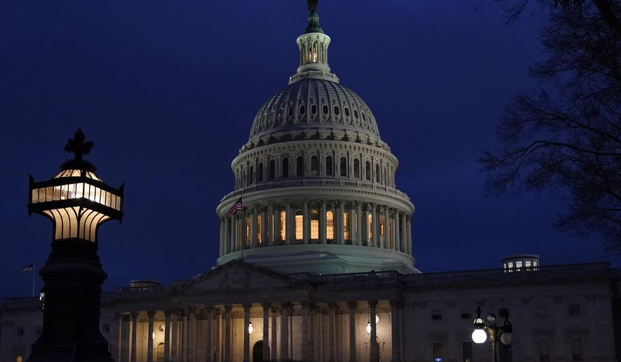 FILE - This Wednesday evening, Jan. 6, 2021 file photo shows the U.S. Capitol in Washington. (AP Photo/Jacquelyn Martin)