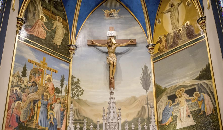 A set of paintings depicting the Resurrection surround a crucifix in the sanctuary of St. Mark's Catholic Church in Peoria, Ill. Peoria artist Andrew Hattermann and the artists of Murals by Jericho have built a successful business painting and beautifying churches all over the country and the world. (Matt Dayhoff/Journal Star via AP)