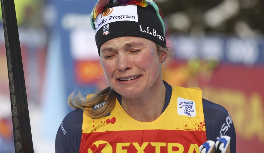 United States' Jessie Diggins bursts into tears after completing a women's Tour de Ski, cross-country 10K mass start event, in Val di Fiemme, Italy, Sunday, Jan. 10, 2021. Diggins finished in second placed and clinched the Tour de Ski trophy. (AP Photo/Alessandro Trovati)