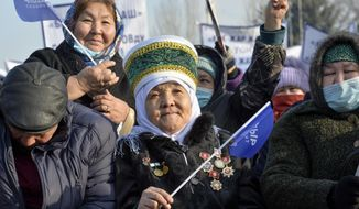 Supporters listen to Kyrgyzstan presidential candidate Sadyr Zhaparov during a meeting in Bishkek, Kyrgyzstan, Friday, Jan. 8, 2021. The presidential election will be held on Sunday, Jan. 10, 2021. (AP Photo/Vladimir Voronin)