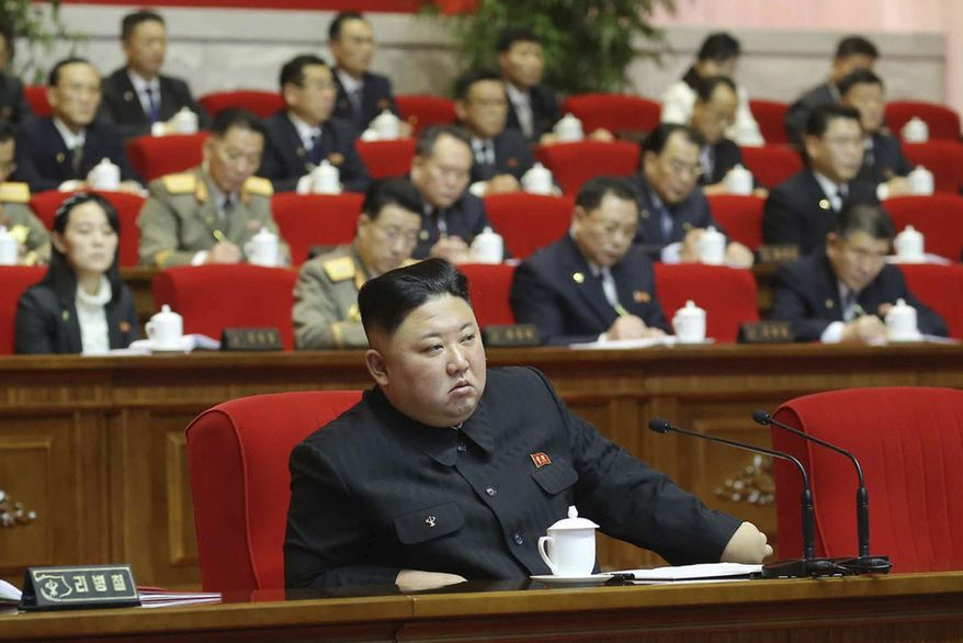 """In this photo provided by the North Korean government, North Korean leader Kim Jong Un, center, attends the ruling party congress in Pyongyang, North Korean, Saturday, Jan. 9, 2021. Independent journalists were not given access to cover the event depicted in this image distributed by the North Korean government. The content of this image is as provided and cannot be independently verified. Korean language watermark on image as provided by source reads: """"KCNA"""" which is the abbreviation for Korean Central News Agency. (Korean Central News Agency/Korea News Service via AP)"""