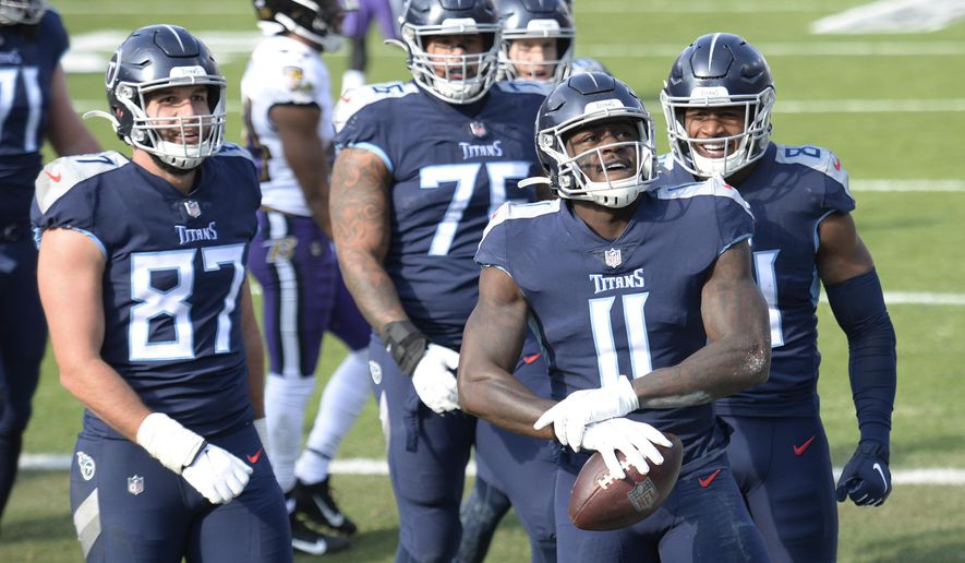 Tennessee Titans wide receiver A.J. Brown (11) celebrates after making a touchdown catch against the Baltimore Ravens in the first half of an NFL wild-card playoff football game Sunday, Jan. 10, 2021, in Nashville, Tenn. (AP Photo/Mark Zaleski)
