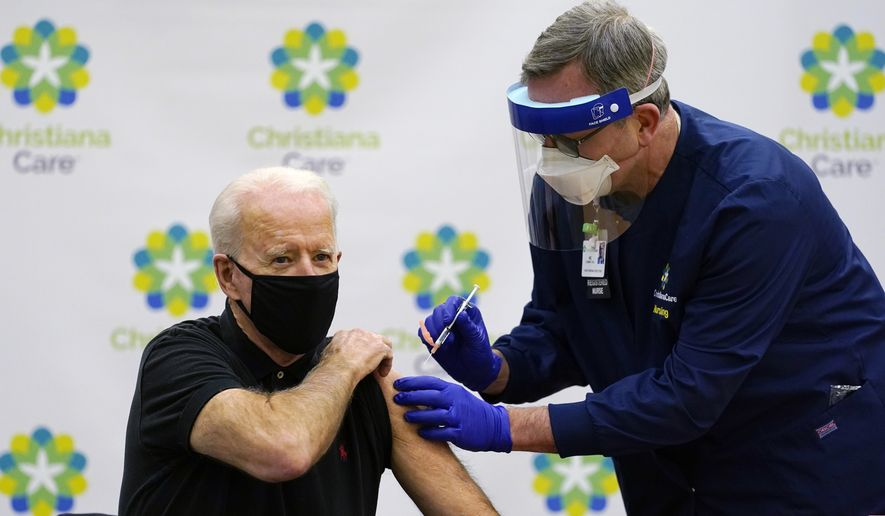 President-elect Joe Biden receives his second dose of the coronavirus vaccine at ChristianaCare Christiana Hospital in Newark, Del., Monday, Jan. 11, 2021. The vaccine is being administered by Chief Nurse Executive Ric Cuming. (AP Photo/Susan Walsh)