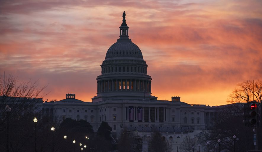 Dawn breaks at the Capitol in Washington, Monday, Jan. 11, 2021. House Speaker Nancy Pelosi, D-Calif., is calling for congressional action to rein in President Donald Trump after inciting last week's deadly assault on the U.S. Capitol. (AP Photo/J. Scott Applewhite)