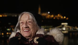 Agnes Keleti, former Olympic gold medal winning gymnast, poses in Budapest, Hungary Monday Jan. 4, 2021. The oldest living Olympic champion turns 100 and says the fondest memory of her remarkable life is simply that she has lived through it all. Agnes Keleti is a Holocaust survivor and winner of five Olympic gold medals in gymnastics and 10 overall. (AP Photo/Laszlo Balogh) **FILE**