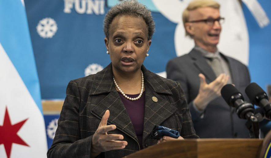 Mayor Lori Lightfoot speaks to reporters after visiting preschool classrooms at Dawes Elementary School in Chicago, Monday, Jan. 11, 2021. Monday was the first day of optional in-person learning for preschoolers and some special education students in Chicago Public Schools after going remote last March due to the coronavirus pandemic. (Ashlee Rezin Garcia/Chicago Sun-Times via AP, Pool)