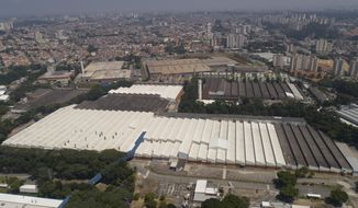 FILE - This March 12, 2020 file photo shows an aerial view of a Ford Motor Company factory in Sao Bernardo do Campo, in the greater Sao Paulo area, Brazil. Ford Motor said on Monday, Jan. 11, 2021, it will close three plants in Brazil and stop producing automobiles in the South American country, but will keep its South America headquarters, product development center and proving grounds in Brazil. (AP Photo/Andre Penner, File)
