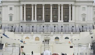 Preparations take place for President-elect Joe Biden's inauguration on the West Front of the U.S. Capitol in Washington, Friday, Jan. 8, 2021, after supporters of President Donald Trump stormed the building. (AP Photo/Patrick Semansky) **FILE**