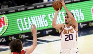 Phoenix Suns forward Dario Saric (20) shoots against Washington Wizards center Robin Lopez, left, during the first half of an NBA basketball game, Monday, Jan. 11, 2021, in Washington. (AP Photo/Nick Wass)