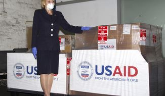 FILE - In this Monday May 11, 2020 file photo supplied by the United States Embassy in Pretoria, shows U.S. Ambassador to South Africa Lana Marks posing with ventilators donated by the U.S. Government at OR Tambo Airport Johannesburg. Marks on Monday, Jan. 11, 2021 said she spent 10 days in a South African hospital's intensive care unit with COVID-19 and is now recuperating at her residence. (Leon Kgoedi/United States Embassy South Africa via AP)