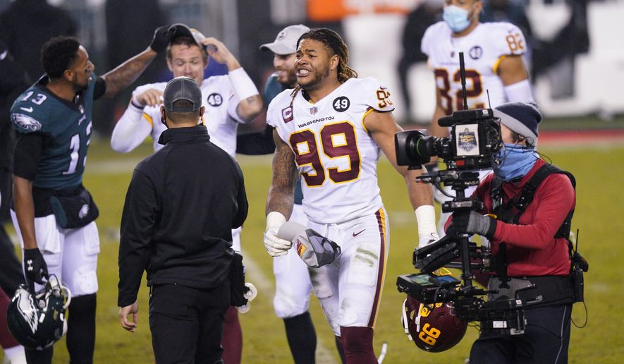 Washington Football Team's Chase Young reacts after an NFL football game against the Philadelphia Eagles, Sunday, Jan. 3, 2021, in Philadelphia. (AP Photo/Chris Szagola)