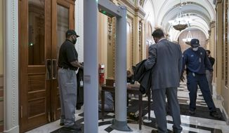 Metal detectors for lawmakers are installed in the corridor around the House of Representatives chamber after a mob loyal to President Donald Trump stormed the Capitol last week, in Washington, Tuesday, Jan. 12, 2021. (AP Photo/J. Scott Applewhite)