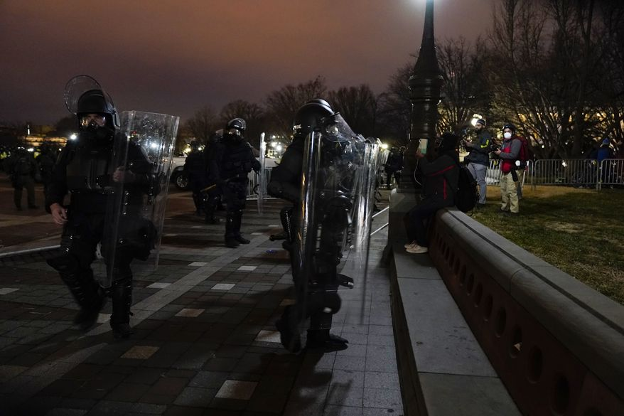 Authorities remove violent protesters from the U.S. Capitol, Wednesday, Jan. 6, 2021, in Washington. (AP Photo/Jacquelyn Martin) **FILE**