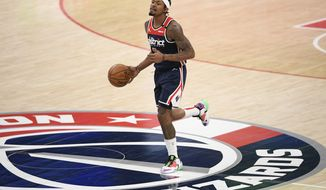 Washington Wizards guard Bradley Beal (3) dribbles the ball during the second half of an NBA basketball game against the Phoenix Suns, Monday, Jan. 11, 2021, in Washington. (AP Photo/Nick Wass)