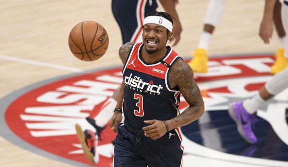 Washington Wizards guard Bradley Beal (3) chases the ball during the first half of an NBA basketball game against the Phoenix Suns, Monday, Jan. 11, 2021, in Washington. (AP Photo/Nick Wass)