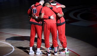The Washington Wizards huddle before an NBA basketball game against the Phoenix Suns, Monday, Jan. 11, 2021, in Washington. (AP Photo/Nick Wass)