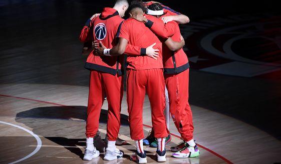 The Washington Wizards huddle before an NBA basketball game against the Phoenix Suns, Monday, Jan. 11, 2021, in Washington. (AP Photo/Nick Wass)