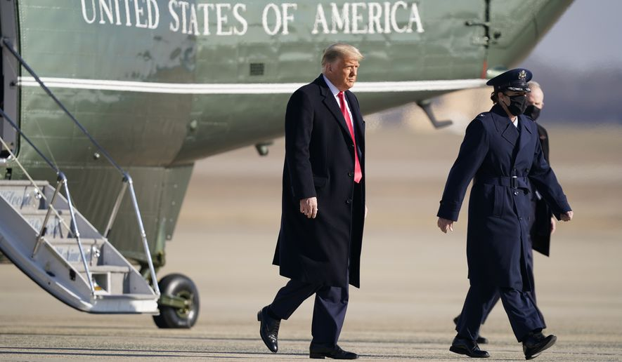 President Donald Trump steps off Marine One before boarding Air Force One at Andrews Air Force Base, Md., for a trip to Texas, Tuesday, Jan. 12, 2021. (AP Photo/Manuel Balce Ceneta)