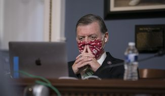 Rep. Tom Cole, R-Okla., the ranking member of the House Rules Committee, listens as the panel considers a resolution calling on Vice President Mike Pence to activate the 25th Amendment to declare President Donald Trump incapable of executing the duties of his office, at the Capitol in Washington, Tuesday, Jan. 12, 2021. House Speaker Nancy Pelosi, D-Calif., is calling for swift congressional action to rein in President Donald Trump after inciting last week's deadly assault on the U.S. Capitol. (AP Photo/J. Scott Applewhite)