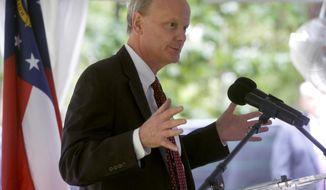 FILE - In this Aug. 29, 2017, file photo, Steve Wrigley, chancellor of the University System of Georgia, speaks at the groundbreaking of the Waters College of Health Profession at Armstrong State University in Savannah, Ga. Wrigley announced Tuesday, Jan. 12, 2020, that he will retire on July 1. (Steve Bisson/Savannah Morning News via AP, File)