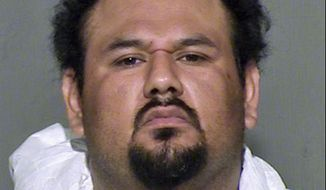FILE - This undated file photo provided by the Maricopa County Sheriff's Office in Arizona shows suspect Apolinar Altamirano, who is charged with murder in the 2015 shooting death of a convenience store clerk in a Phoenix suburb. Prosecutors have asked the Arizona Court of Appeals to reverse a lower-court ruling that threw out the state's intent to seek the death penalty against Altamirano. (Maricopa County Sheriff's Office via AP)