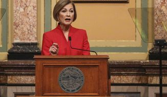 Iowa Gov. Kim Reynolds delivers her Condition of the State address before a joint session of the Iowa Legislature, Tuesday, Jan. 12, 2021, at the Statehouse in Des Moines, Iowa. (Bryon Houlgrave/The Des Moines Register via AP)