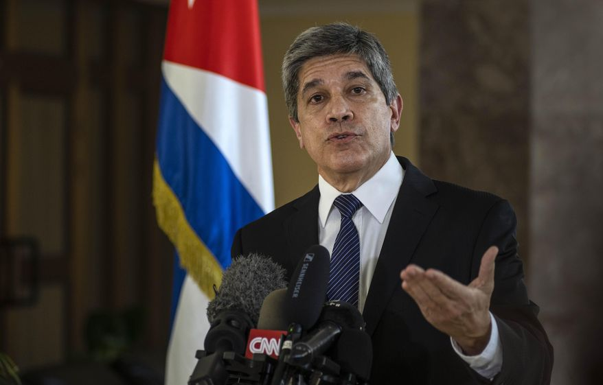 """Cuba's Director General of U.S. Affairs Carlos Fernandez de Cossio speaks at a press conference in Havana, Cuba, Tuesday, Jan. 12, 2021. The Trump administration has re-designated Cuba as a """"state sponsor of terrorism"""" in a move that hits the country with new sanctions shortly before President-elect Joe Biden takes office. (AP Photo/Ramon Espinosa)"""