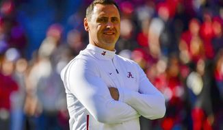 FILE - In this Nov. 9, 2019, file photo, Alabama offensive coordinator Steve Sarkisian watches warm-ups before an NCAA football game against LSU in Tuscaloosa, Ala. Sarkisian made the most of his final game with Alabama and three of the most dangerous weapons in college football during the College Football Playoff national championship game against Ohio State on Monday, Jan. 11, 2021. (AP Photo/Vasha Hunt, File)