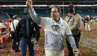 Alabama head coach Nick Saban leaves the field after their win against Ohio State in an NCAA College Football Playoff national championship game, Tuesday, Jan. 12, 2021, in Miami Gardens, Fla. Alabama won 52-24. (AP Photo/Lynne Sladky)