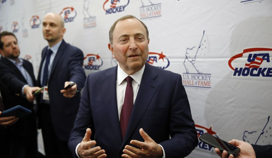 NHL Commissioner Gary Bettman speaks with members of the media before being inducted into the U.S. Hockey Hall of Fame in Washington, in this Thursday, Dec. 12, 2019, file photo. (AP Photo/Patrick Semansky, File)