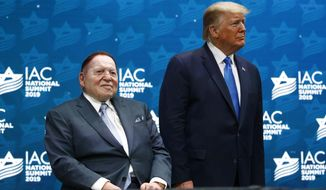 In this Dec. 7, 2019, file photo, President Donald Trump stands alongside Las Vegas Sands Corporation Chief Executive and Republican mega-donor Sheldon Adelson before speaking at the Israeli American Council National Summit in Hollywood, Fla. Adelson, the billionaire mogul and power broker who built a casino empire spanning from Las Vegas to China and became a singular force in domestic and international politics has died after a long illness, his wife said Tuesday, Jan. 12, 2021. (AP Photo/Patrick Semansky, File)