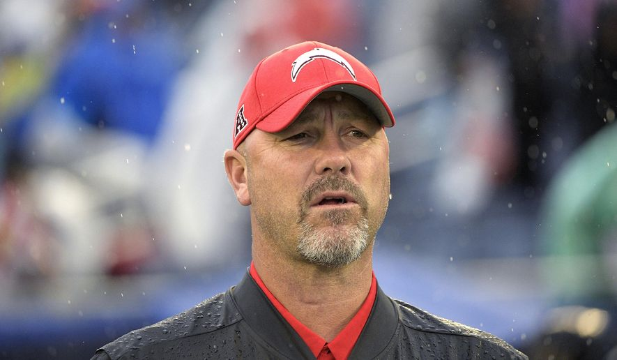 FILE - AFC defensive coordinator Gus Bradley, of the Los Angeles Chargers, watches during the first half of the NFL Pro Bowl football game against the NFC, in Orlando, Fla., in this Sunday, Jan. 27, 2019, file photo. The Las Vegas Raiders have hired Gus Bradley as their new defensive coordinator with the task of turning around one of the league's worst units. Coach Jon Gruden decided to bring on the experienced Bradley on Tuesday, Jan. 12, 2021, to fill that role Paul Guenther had for the first two-plus seasons on his staff before being fired in December. (AP Photo/Phelan M. Ebenhack, File)