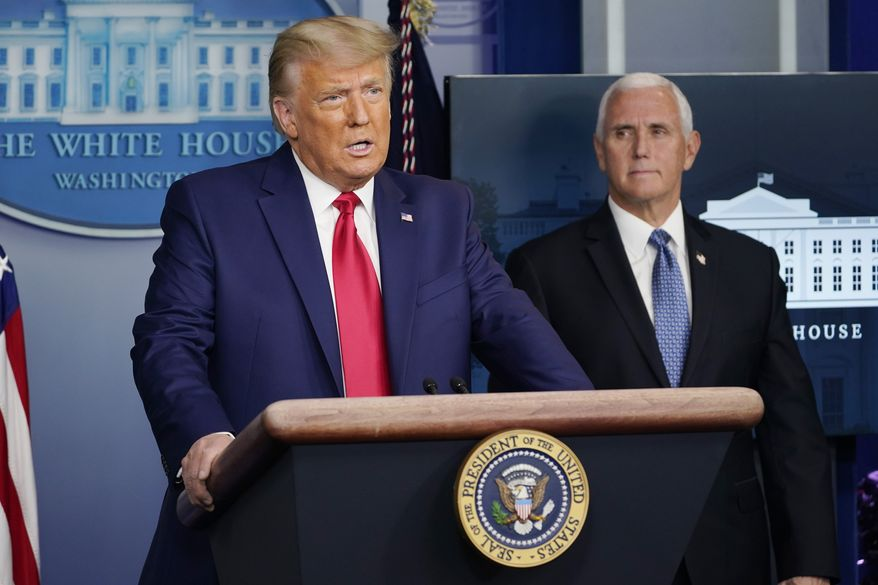 President Donald Trump and Vice President Mike Pence in an undated file photo. (Associated Press photograph)  **FILE**