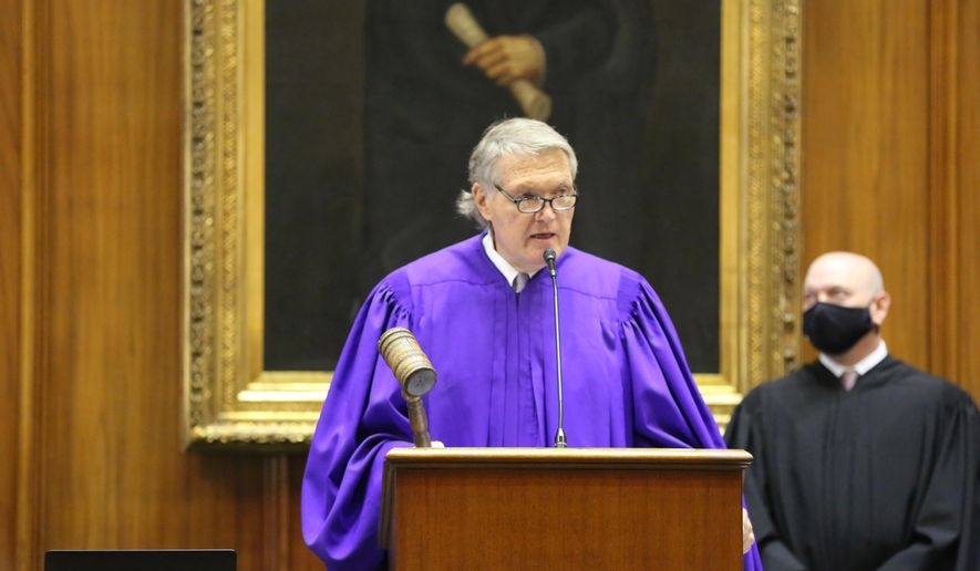 South Carolina Senate President Harvey Peeler presides over the Senate after being reelected to his leadership position at the Statehouse in Columbia, S.C., on Tuesday, Jan. 12, 2021. This is the first year of a two-year session. (AP Photo/Jeffrey Collins)