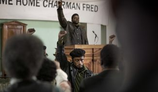 """This image released by Warner Bros. Pictures shows LaKeith Stanfield, foreground, and Daniel Kaluuya in a scene from the upcoming film """"Judas and the Black Messiah.""""   The Ryan Coogler-produced Fred Hampton film will have its premiere at the Sundance Film Festival before heading to HBO Max and theaters, programmers announced Tuesday. Daniel Kaluuya plays the Black Panther Party chairman and his """"Get Out"""" co-star Lakeith Stanfield plays FBI Informant William O'Neill who agrees to infiltrate the group in the late 1960s. (Glen Wilson/Warner Bros. Entertainment via AP)"""