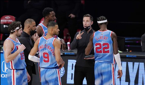 Brooklyn Nets head coach Steve Nash talks to Nets' Joe Harris (12), Jeff Green, Timothe Luwawu-Cabarrot (9) and Caris LeVert (22) during the second half of an NBA basketball game against the Oklahoma City Thunder, Sunday, Jan. 10, 2021, in New York. The Thunder defeated the Nets 129-116. (AP Photo/Kathy Willens) **FILE**