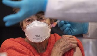 "Renee Dunn, 84, gets the coronavirus vaccine at a clinic organized by New York City's Department of Health, Monday, Jan. 11, 2021. ""I worked in healthcare for many years,"" she said. It is so lucky we have this vaccine."" Monday is the first day in New York that those 75 years of age and older can get the vaccine. (AP Photo/Mark Lennihan)"