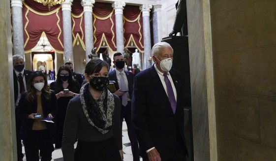 House Majority Leader Steny Hoyer, D-Md., walks to House Speaker Nancy Pelosi's office on Capital Hill, Wednesday, Jan. 13, 2021, in Washington, as the House of Representatives is pursuing an article of impeachment against President Donald Trump for his role in inciting an angry mob to storm the Capitol last week. (AP Photo/Alex Brandon)