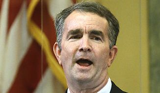 Gov. Ralph Northam delivers his State of the Commonwealth speech inside the State Capitol in Richmond, VA Wednesday, Jan. 13, 2021. Members watched virtually due to COVID-19 restrictions. (Bob Brown/Richmond Times-Dispatch via AP) **FILE**