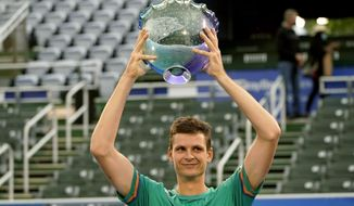 Hubert Hurkacz of Poland, holds the trophy after defeating Sebastian Korda 6-3, 6-3 during the men's singles final of the Delray Beach Open tennis tournament, Wednesday, Jan. 13, 2021, in Delray Beach, Fla. (AP Photo/Lynne Sladky)