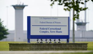 This Aug. 28, 2020, file photo shows the federal prison complex in Terre Haute, Ind. (AP Photo/Michael Conroy, File)