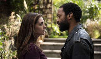 """This image released by HBO Max shows Anne Hathaway and Chiwetel Ejiofor in a scene from """"Lockdown."""" (Susie Allnutt/HBO Max via AP)"""