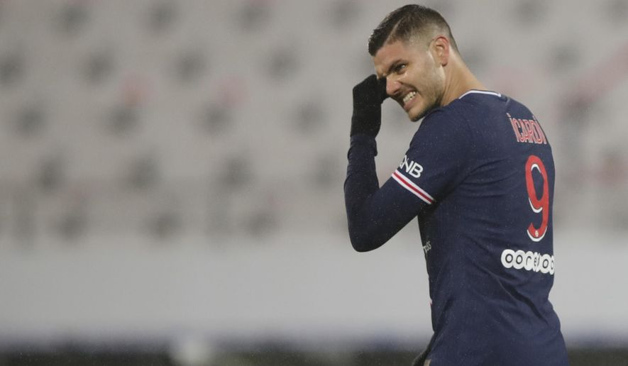 PSG's Mauro Icardi reacts after missing a chance to score during the Champions Trophy soccer match between Paris Saint-Germain and Olympique Marseille at the Bollaert stadium in Lens, northern France, Wednesday, Jan.13, 2021. (AP Photo/Christophe Ena)