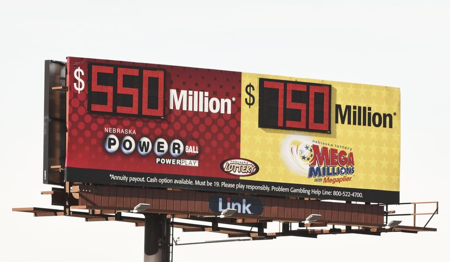 A billboard advertises the jackpots of the Powerball and Mega Millions lotteries, in Omaha, Neb., Wednesday, Jan. 13, 2021. Lottery players will have a shot Friday night at the fifth-largest jackpot in U.S. history after no tickets matched all the numbers in the latest Mega Millions drawing. The big prize for Powerball, the other national lottery game, is $550 million for Wednesday night's drawing. (AP Photo/Nati Harnik)