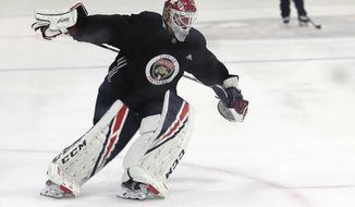 """FILE - Florida Panthers goaltender Sergei Bobrovsky skates during NHL hockey practice in Coral Springs, Fla., in this July 17, 2020, file photo. The Florida Panthers got goaltender Sergei Bobrovsky back Wednesday, Jan. 13, 2021, the two-time Vezina Trophy winner joining the club on the ice for the first time since training camp started. He had been on the """"unfit to play"""" list for the first nine days of camp. (AP Photo/Lynne Sladky, File)"""