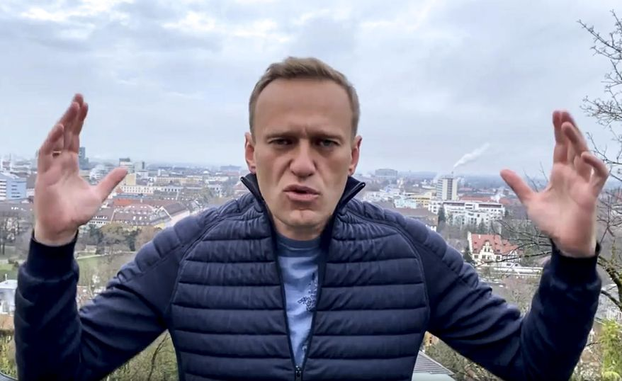 In this handout photo taken from a video released on Wednesday, Jan. 13, 2021, by Russian opposition activist Alexei Navalny in his instagram account, Russian opposition activist Alexei Navalny gestures as he records his address. Top Kremlin critic Alexei Navalny says he will fly home to Russia over the weekend despite the Russian prison service's latest motion to put him behind bars for allegedly breaching the terms of his suspended sentence and probation. (Navalny instagram account via AP)